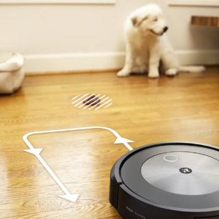 Робот-пылесос и собака
